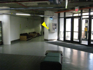 arrow pointing to blue light phone in Applied Technology building by vending area